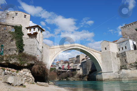 Old Bridge in Mostar stock photo, Old Bridge in Mostar, Bosnia and Herzegovina with the old town and blue sky in background by Denis Radovanovic