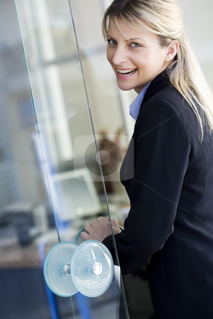Happy employee stock photo, Buisness woman or office worker on her way to work, or a happy customer entering a bank etc. by Liv Friis-Larsen