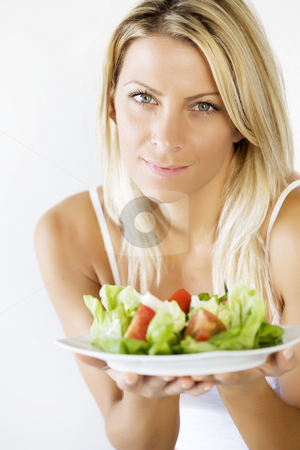 Healthy eating stock photo, Young female holding fresh salad by Liv Friis-Larsen