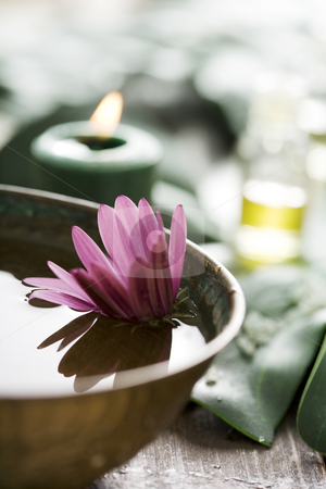 Aromatherapy setup stock photo, Bowl,candle oil on banana leafs by Liv Friis-Larsen