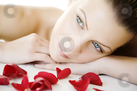 Beauty stock photo, Closeup of young beautiful female face, lying on a bed, maybe enjoying a beauty-treatment. by Liv Friis-Larsen