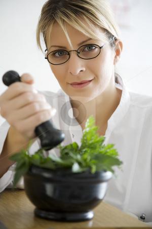 Herbal medicine stock photo, Pharmacist mixing herbal remedies by Liv Friis-Larsen