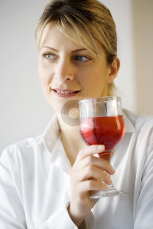 Drinking wine stock photo, Woman enjoying a glass of wine by Liv Friis-Larsen