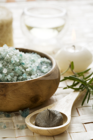 Spa products stock photo, Bath-salt,mud,candle and oil in the background, focus on the mud in frony by Liv Friis-Larsen