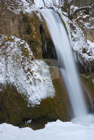Waterfall in winter stock photo, Waterfall surrounded with snow and icicles by Ivan Paunovic