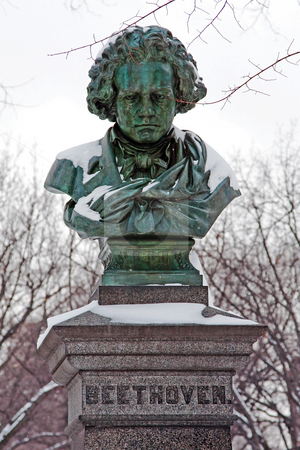 Statue of Ludwig van Beethoven stock photo, Snow covered green copper statue of Ludwig van Beethoven in the mall in Central Park, New York City by Paul Hakimata