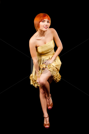 Sexy redhead in yellow dress stock photo, Beautiful sexy Caucasian redhead woman in pulling up yellow cocktail dress and having one leg up, isolated by Paul Hakimata