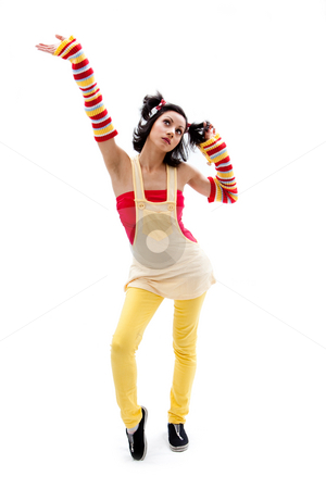 Fun girl standing stock photo, Beautiful fun latina girl with bright colored arm warmers and ponytails with red ribbons in her hair standing with hand in air, isolated by Paul Hakimata