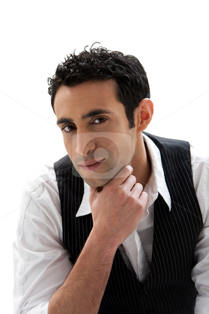 Handsome guy stock photo, Handsome male wearing a white shirt and black pinstripe vest and hand under chin, isolated by Paul Hakimata