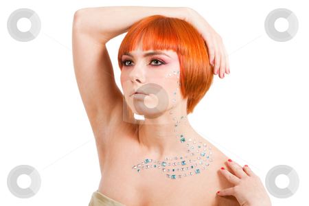 Redhead with rhinestones stock photo, Beautiful redhead Caucasian girl with rhinestones and arm around her head and hand on shoulder, isolated by Paul Hakimata