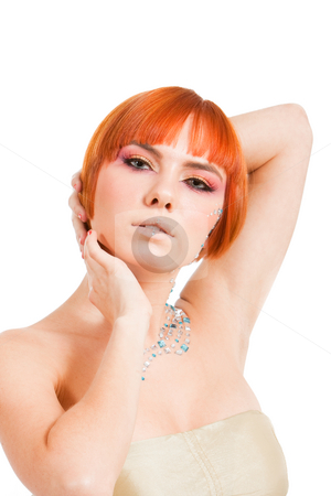 Redhead with rhinestones stock photo, Beautiful redhead Caucasian girl with rhinestones and arms around her head, isolated by Paul Hakimata