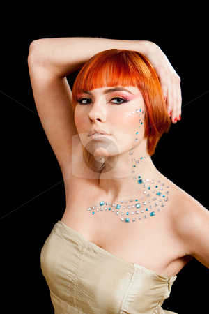 Redhead with rhinestones stock photo, Beautiful face of a redhead Caucasian girl with rhinestones and hand over her head, isolated by Paul Hakimata