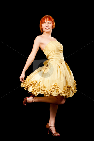 Redhead in yellow dress stock photo, Beautiful Caucasian redhead woman in yellow cocktail dress with leg up having fun, isolated by Paul Hakimata