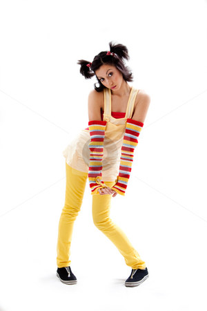 Fun girl standing stock photo, Beautiful fun latina girl with bright colored arm warmers and ponytails with red ribbons in her hair standing with hand down, isolated by Paul Hakimata