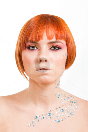 Redhead with rhinestones stock photo, Beautiful face of a redhead Caucasian girl with sea blue eyes and rhinestones, isolated by Paul Hakimata