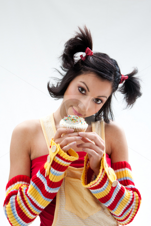 Cupcake girl stock photo, Beautiful Latina girl with huge eyes open holding a cupcake, isolated by Paul Hakimata