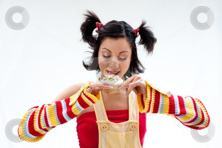 Cupcake girl stock photo, Beautiful Latina girl licking a cupcake, isolated by Paul Hakimata