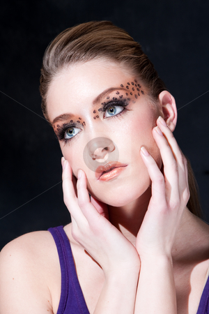 Beatiful face with Leopard print eyes stock photo, Tilted face of a beautiful dirty-blond girl with leopard print eyeshadow, isolated by Paul Hakimata