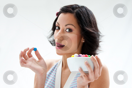 Happy candy girl stock photo, Happy beautiful candy girl with a bowl of colorful bubblegum candy balls licking her lip, isolated by Paul Hakimata