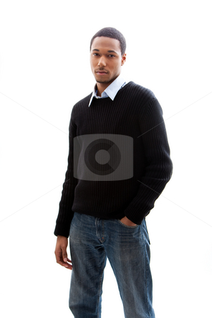 Handsome man stock photo, Handsome African American male in blue shirt black sweater and jeans standing, isolated by Paul Hakimata