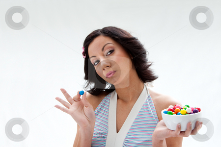 Happy candy girl stock photo, Happy beautiful candy girl with a bowl of colorful bubblegum candy balls thinking, isolated by Paul Hakimata