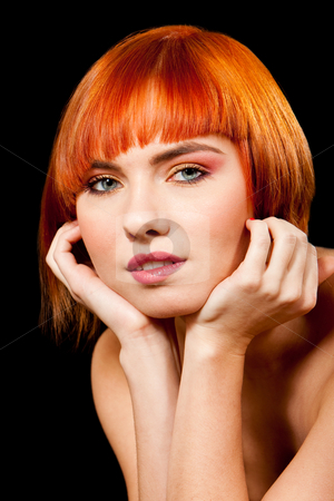 Beautiful redhead face stock photo, Face of a beautiful Caucasian redhead girl with glossy blue eyes supporting her head with hands, isolated by Paul Hakimata