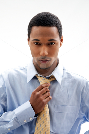 Handsome man stock photo, Handsome African American male in blue shirt and yellow tie, isolated by Paul Hakimata