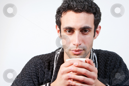 Man with cup stock photo, Tired handsome man with a mug wearing a black robe, isolated by Paul Hakimata