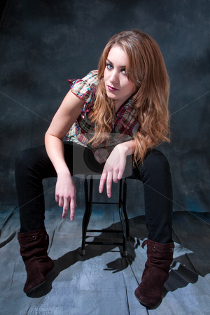 Dirty-blond sitting on stool stock photo, Beautiful dirty-blond girl sitting on stool with attitude by Paul Hakimata