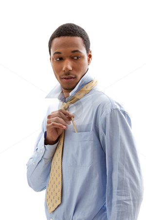 Handsome man stock photo, Handsome African American male in blue shirt and yellow tie putting pen in pocket, isolated by Paul Hakimata