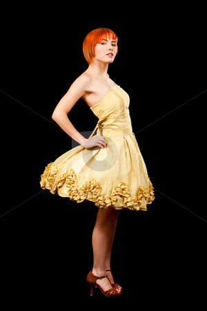 Redhead in yellow dress stock photo, Beautiful Caucasian redhead woman in yellow cocktail dress standing with attitude, isolated by Paul Hakimata