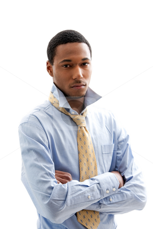 Handsome man stock photo, Handsome African American male in blue shirt and yellow tie with arms crossed and collar up, isolated by Paul Hakimata