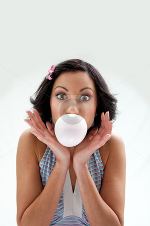 Bubblegum girl stock photo, Beautiful Latina girl with huge eyes open blowing a bubblegum bubble, isolated by Paul Hakimata