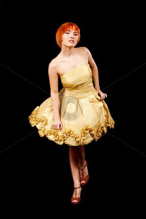 Redhead in yellow dress stock photo, Beautiful Caucasian redhead woman in yellow cocktail dress in playful pose, isolated by Paul Hakimata