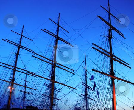 Sailing ship fragment stock photo, Fragment of sailing ship over blue evening sky by Julija Sapic