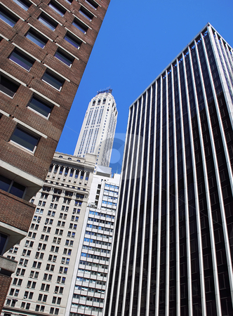 Office modern buildings stock photo, Modern office buildings in New York over blue sky by Julija Sapic