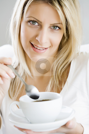 Enjoying coffee stock photo, Woman enjoying a cup of coffee by Liv Friis-Larsen