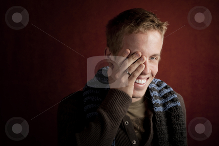 Young man covering his face stock photo, Young man covering face with his hand by Scott Griessel