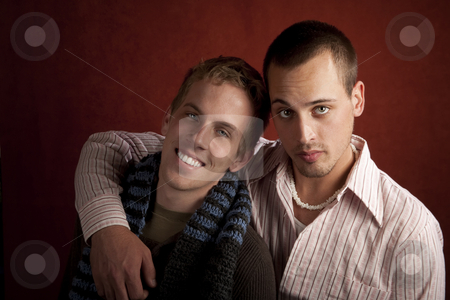 Two Young Men stock photo, Portrait of two young men embracing in studio by Scott Griessel