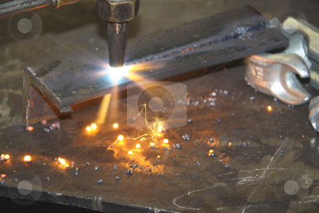 Oxyacetylene Torch throwing sparks while cutting steel stock photo, Oxyacetylene Torch throwing sparks while cutting steel by Chris Alleaume