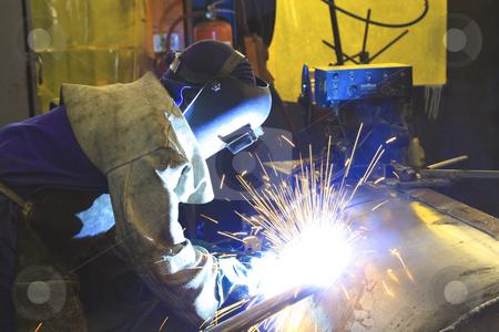 Labourer welding a custom steel tank stock photo, Labourer welding a custom steel tank by Chris Alleaume