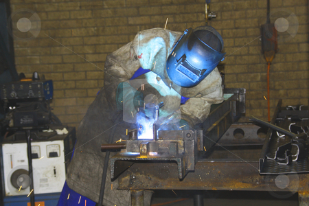 Artisan welding stock photo, Artisan welding pieces of metal by Chris Alleaume