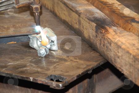 Blow torch starting to cut through a sheet of steel stock photo, Blow torch starting to cut through a sheet of steel by Chris Alleaume