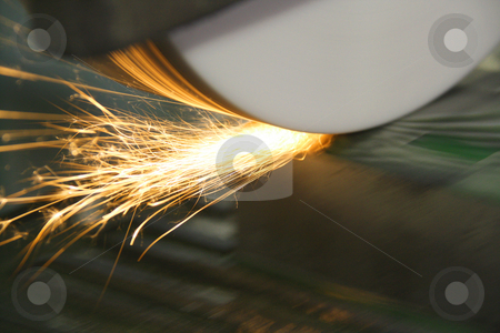 Sparks from Grinder on Die stock photo, Grinder resurfacing a die tool made of steel showing sparks and flares by Chris Alleaume