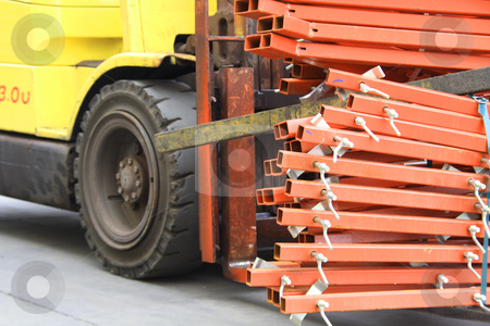 Forklift carrying poles stock photo, Forklift carrying poles by Chris Alleaume
