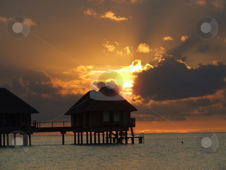 Tropical sunset stock photo, Golden tropical sunset before a storm by Chris Alleaume