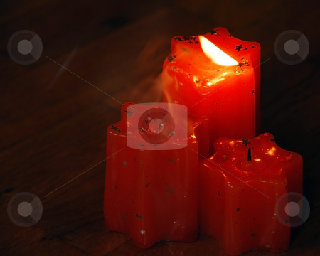 Blowing  candles stock photo, Blowing flame of orange candles with smoke by Julija Sapic