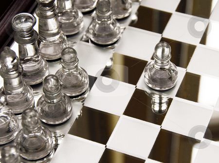 Chessboard stock photo, Glass chessboard with first beginning position of pawn by Julija Sapic