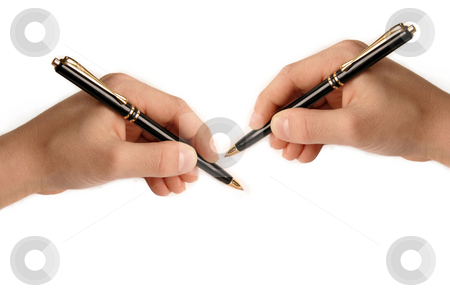 Hands writing on white paper stock photo, Both right and left hands writing nothing on white background by Julija Sapic