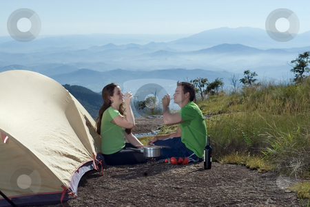 Couple Drinking Wine Outdoors stock photo, Young, attractive couple enjoying a glass of wine while camping outdoors by Orange Line Media
